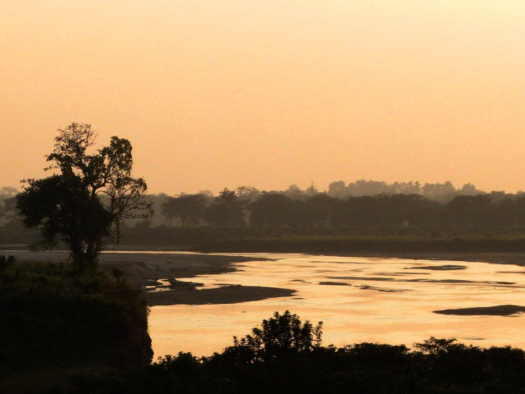 Sunset in Dooars overlooking a river