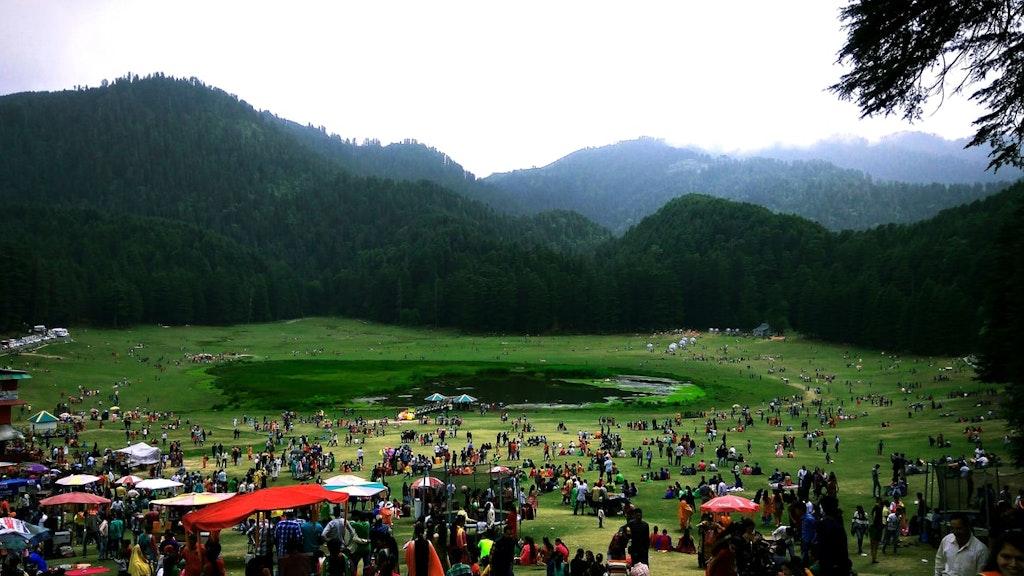 Khajjar lake surrounded by tourists