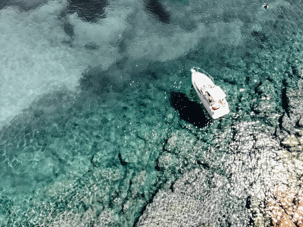 a ferry floating in the sea
