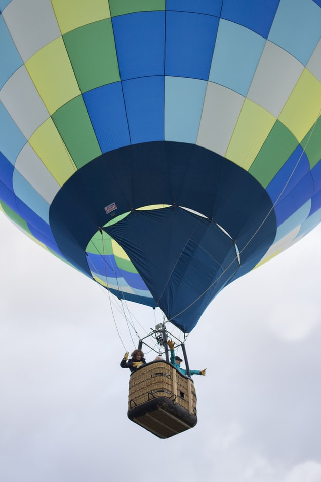 a hot air balloon with travellers
