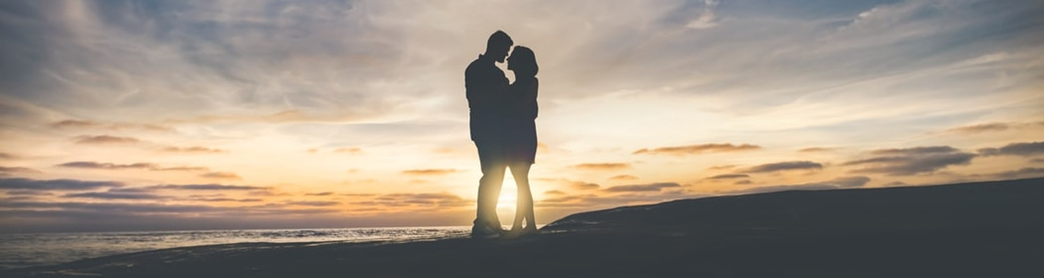 A silhouette image of a couple