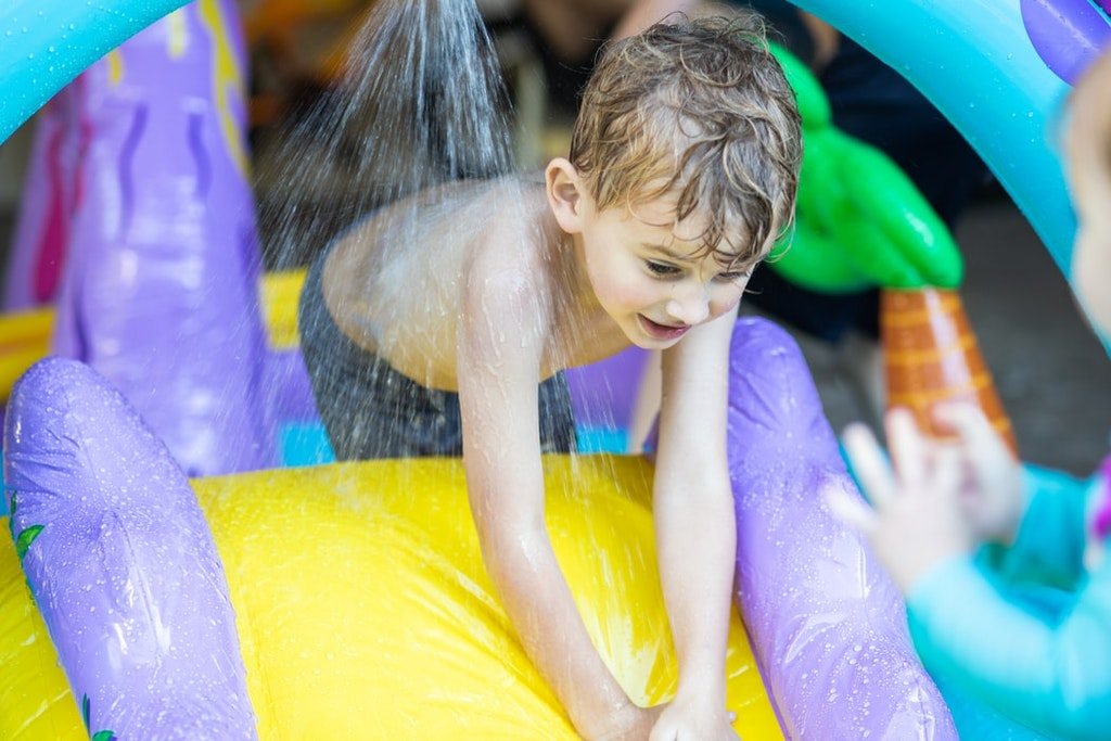 Kid playing at the water parks in New Zealand