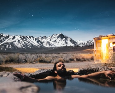 A man relaxing in a hot spring