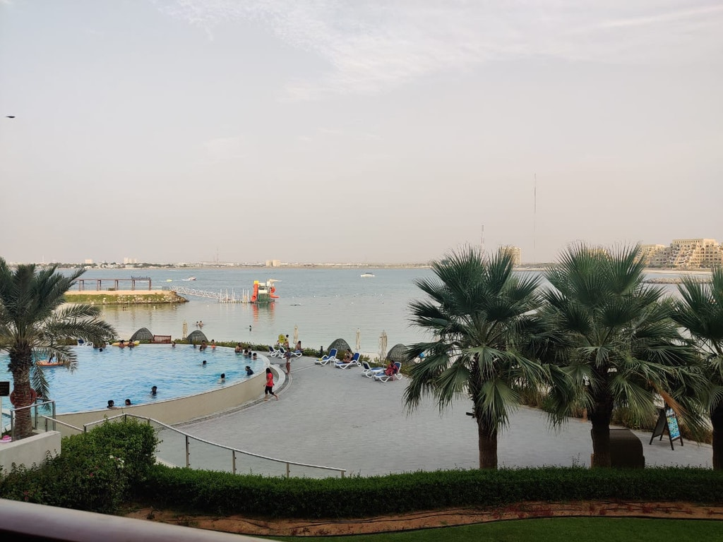 The view of swimming pool and beach