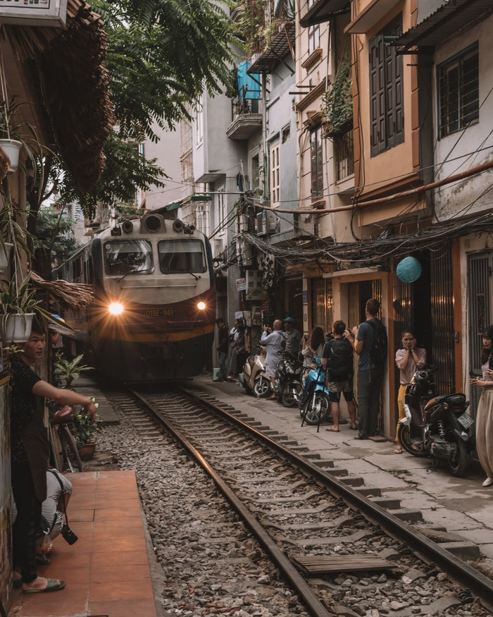 rushing train in the Train street in Hanoi