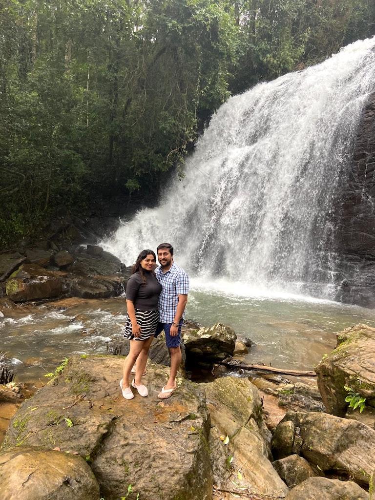 Posing before the waterfalls