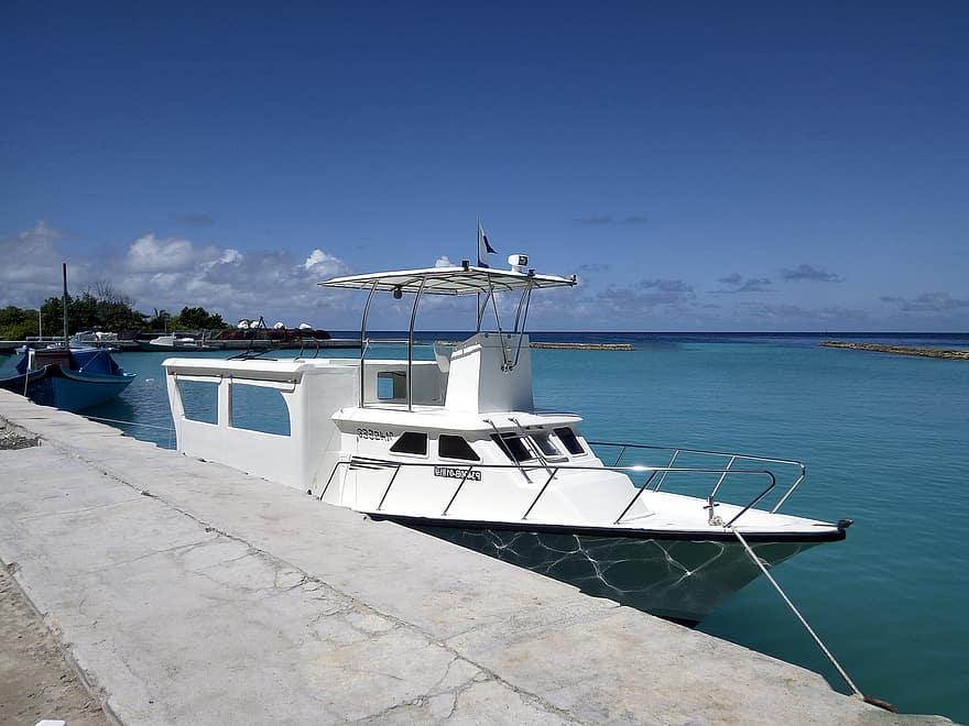 Speedboat docked in the port.