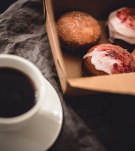 A cup of tea and sweet breads