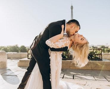 Groom kissing bride's neck