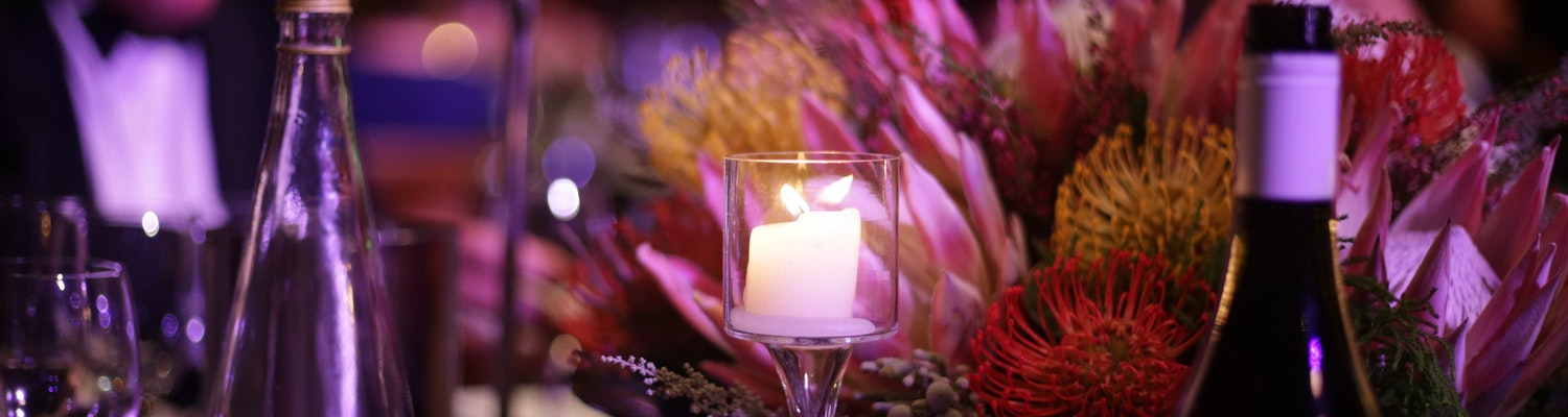 A click of wine, candle and flowers