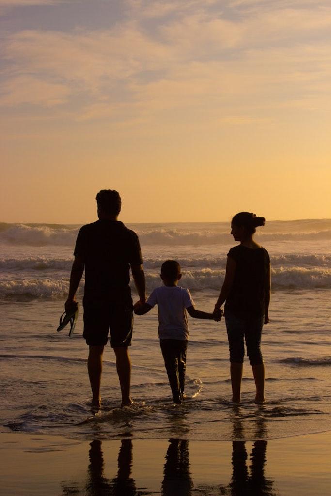 Family enjoying at Marari beach in Kerala
