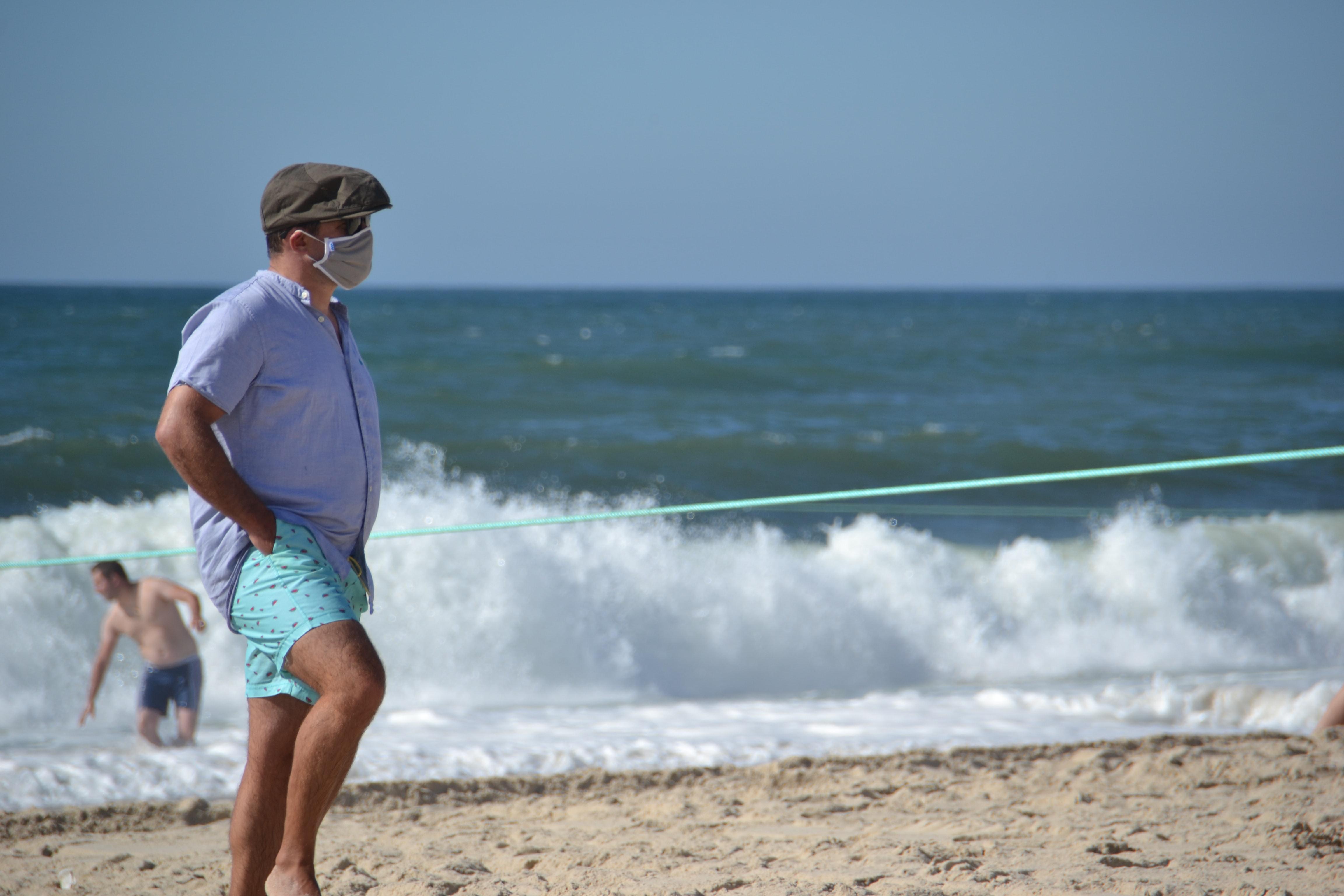 Man wearing mask at a beach.