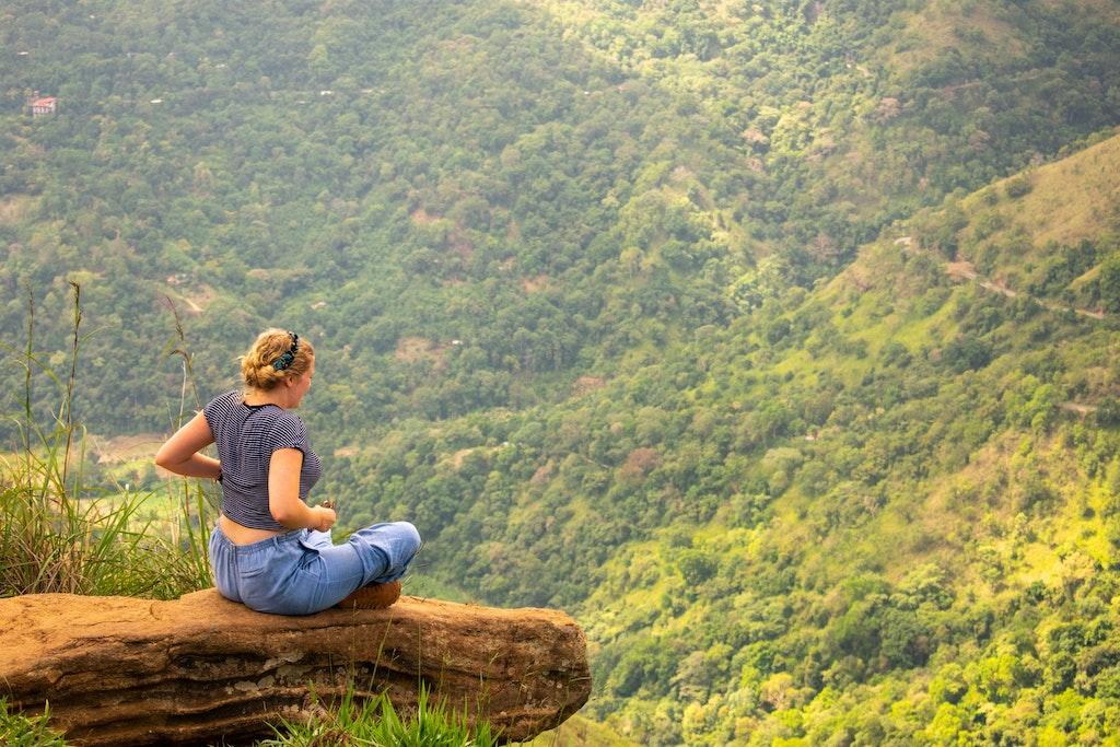 a woman sitting at Adam's Peak, Sri Lanka