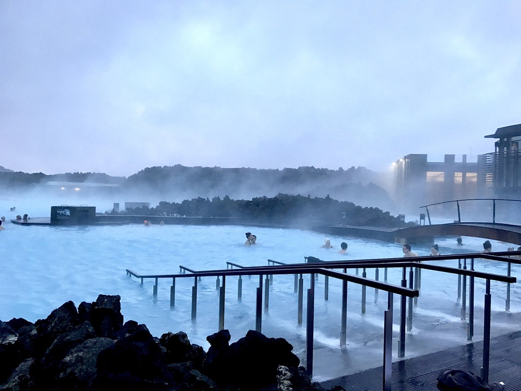 People swimming in blue lagoon Iceland