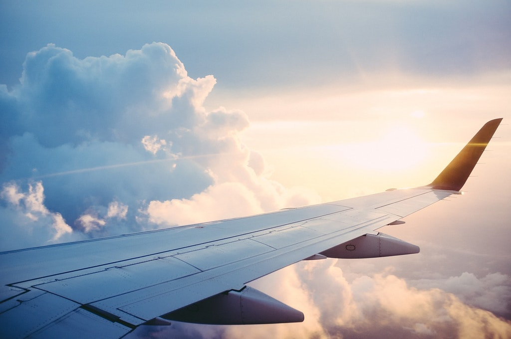 plane-wing-flight-sky-clouds-How to Reach Austria from India